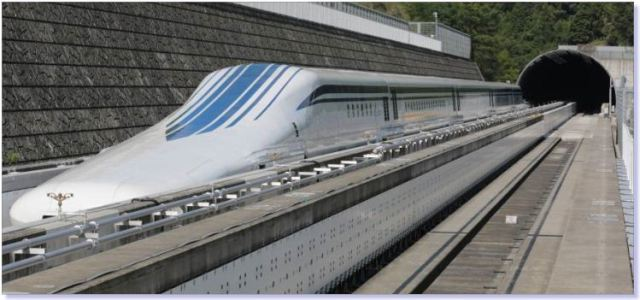 The L0 (L-zero) series magnetic-levitation train, developed by Central Japan Railway Company sits parked on a test track at the control center before a trial run in Tsuru, Yamanashi Prefecture.