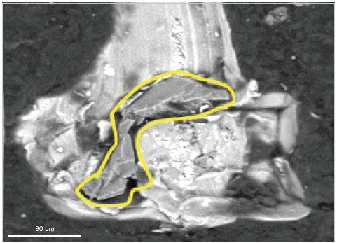 SEM HDBSE image of a sharp multi-faceted Al2O3 particle at the score mark termination (yellow outlined area). (Dark outlying area is carbon rich skirt coating).