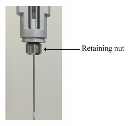 Illustration of the retaining nut in the PEAQ-ITC pipette unit. The retaining nut is indicated with an arrow and label.