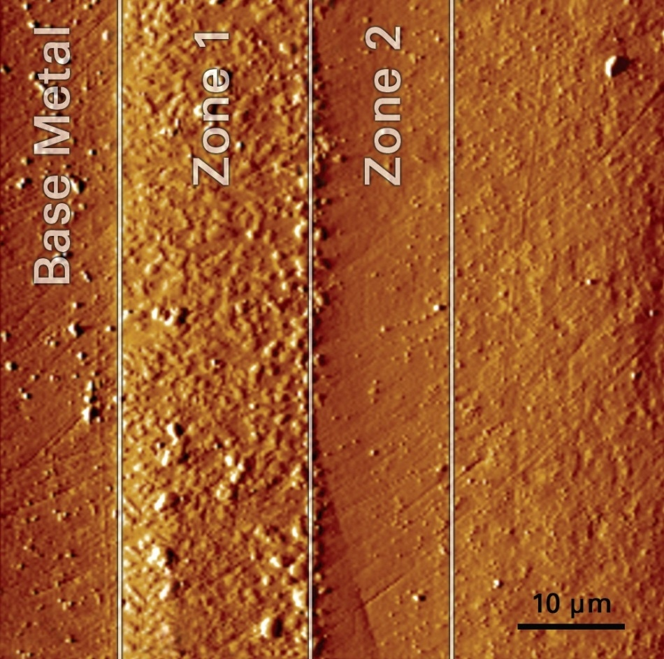 SPM image of the cross-sectioned sample surface showing the bond coat layers that were characterized. Images are collected with the same probe tip used to perform the tests, permitting very precise test positioning.