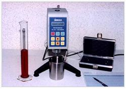 A viscometer is used to measure the flowability of an adhesive.