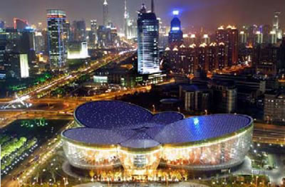 The Shanghai Oriental Arts Center glows beautifully at night.