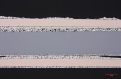 The entire solar cells interconnect shows both the top and bottom soldered seams. The solder is not uniform and lacking at each end of the bottom seam.