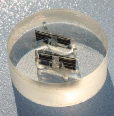 Solar cell interconnects mounted in EpoxiCure® epoxy.