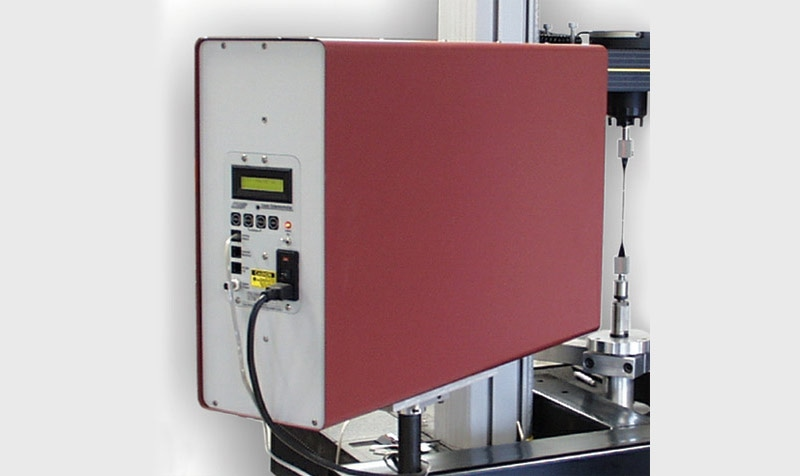 Non-Contacting Laser Extensometers for Strain Measurement in Materials Testing