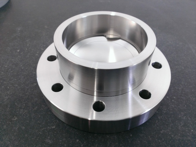 The Ultra Low-Pressure Burst Disc with a rupture pressure below 0.5 bar on 63CF flange. With this component, overpressure regulations do not apply for the system.