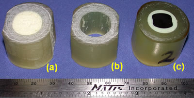 AZoJoMo – AZoM Journal of Materials Online - Stages of preparation of implant test samples: (a) original section of artificial femur, (b) reamed, and (c) final test sample.