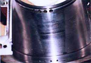 Damage to bearing surface due to motor misalignment